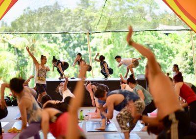Young ho Kim teaching a community yoga class in Bali