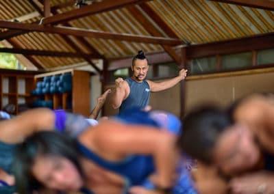 yoga instructor teaching a yoga class in Bali