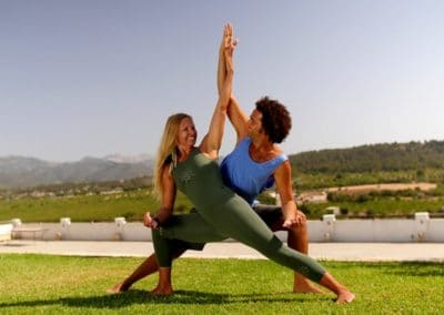 David Lurey and Mirjam Wagner doing a couple yoga asana and eagle pose with their arms