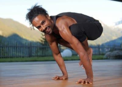 Yoga instructor doing crow yoga asana