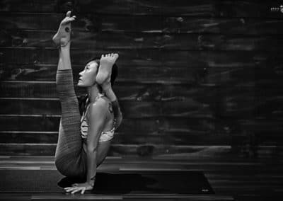 women in twisted hand balance position