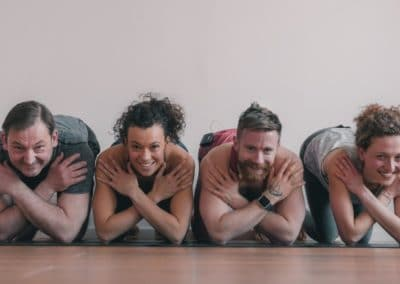 Four yogis crossing their arms in front of their chests