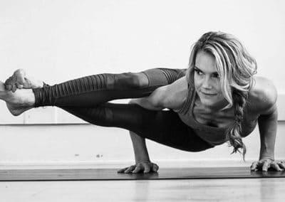 Kristin McGee doing side crow yoga asana