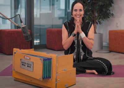 Katchie Ananda recording an online yoga class