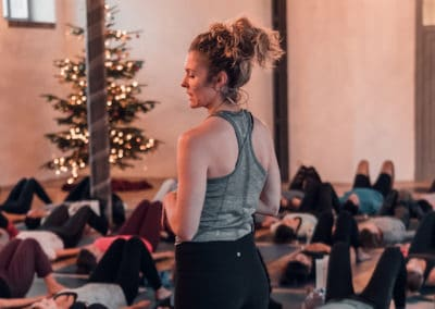 Alexandra Harfield teaching a yoga class during Christmas time