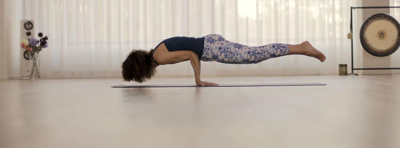 Desirée Rumbaugh doing Peacock yoga pose