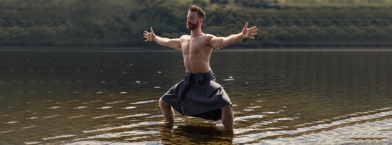 Finlay Wilson in a Forrest Yoga pose standing in a lake