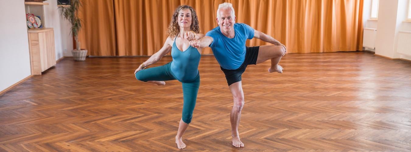 John Friend and Desi Springer in standing Bowspring Yoga pose