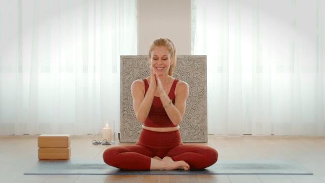 Cristi Christensen rubbing her palms to prepare for yoga mudra