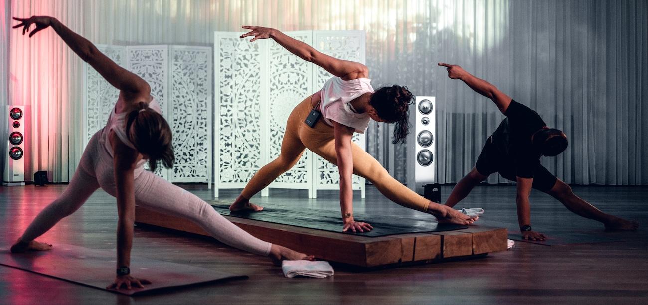 Yoga teachers doing yoga to music